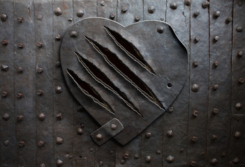 metal heart with claw damage