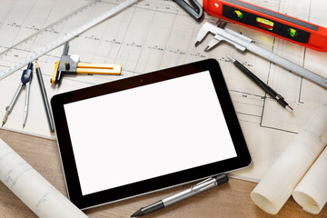 Tablet computer with construction tools and blueprints