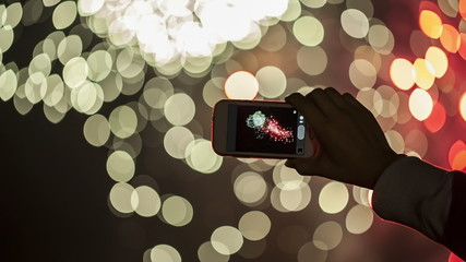 Making video with cell phone at fireworks show.