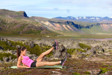 Fitness woman exercising in nature