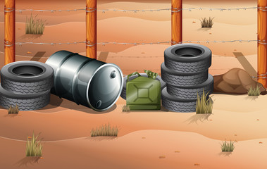 Wheels and fuel containers near the barbwire fence