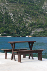 Table and benches on the pier of Kotor Bay. Montenegro