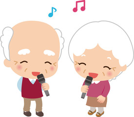 マイクを持って歌う高齢の男女