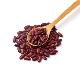 Red beans in a wooden spoon, white background