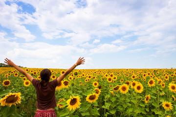 woman in sunflowers field