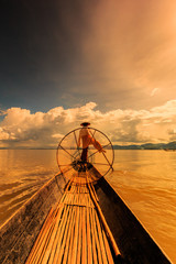 Myanmar fisherman at Inle lake catch fish with tradition style
