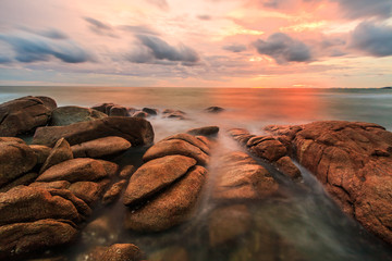 Rocks and wave at the sea in the sunset, Thailand