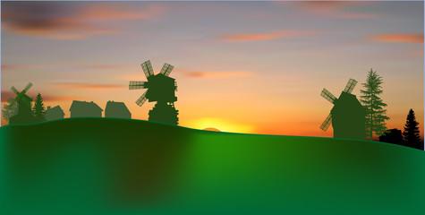 green landscape with three windmills