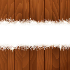 Snow banner on a wooden background