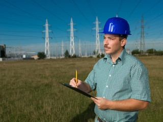 technician inspecting electricity station
