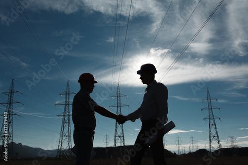 Leinwanddruck Bild electricity station handshake