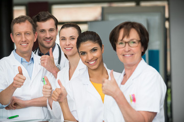 Portrait of medical-team showing thumbs up