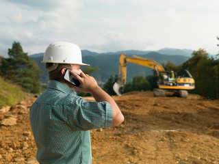male engineer talking on the phone