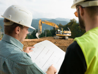contractors reading construction plans