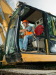 male worker operating excavator - 71210047