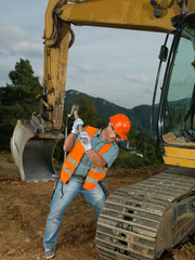 repairman fixing excavator track