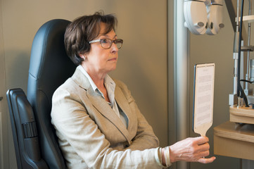 Female patient having eye examination in an optometrist clinic