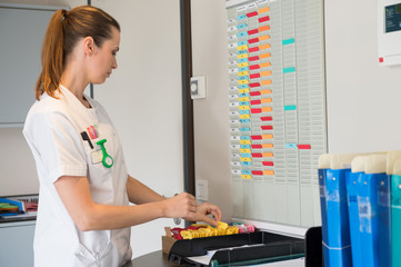 Female nurse arranging schedule in hospital