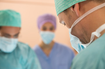Medical team performing an operation in an operating room