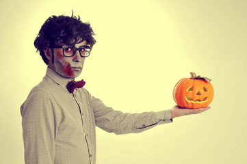 hipster zombie with a jack-o-lantern, with a retro effect