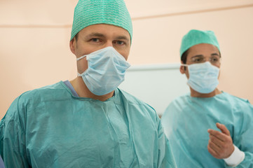 Two male surgeons in an operating room