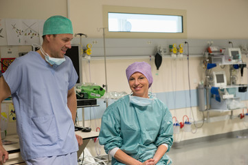 Male and female surgeons in recovery room