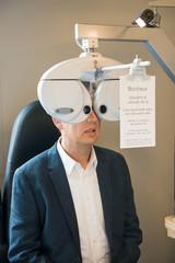 Male patient having eye examination