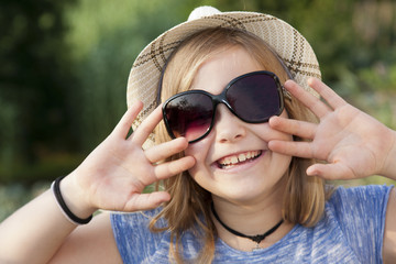 grunge girl portrait with hat and sunglasses