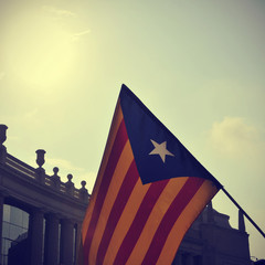 the estelada, the Catalan pro-independence flag, against the sky