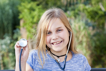 portrait of little girl with stethoscope in hand