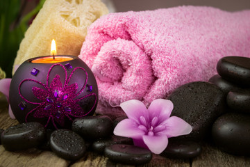 Spa setting with candles and spa stones
