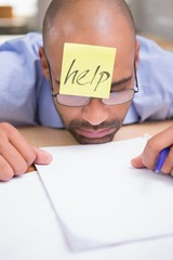 Tired businessman needs help