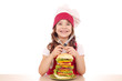 little girl cook with big hamburger on table
