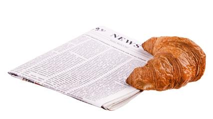 Croissant mit Zeitung