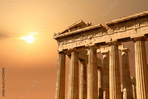 Staande foto Athene Ruins isolated on sunset orange sky with copy-space