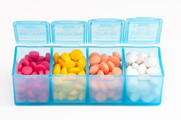 colorful medicine in a pill box