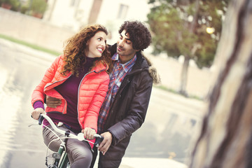 couple in love riding a bicycle together