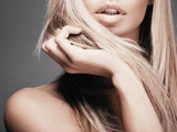 Beautiful woman with long straight blond hair. Fashion model pos - 71216680