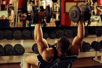 bodybuilder training gym, incline dumbbell press
