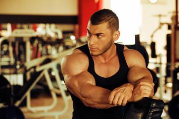 bodybuilder training gym, taking a break