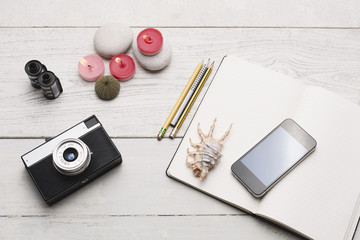 Retro and modern gadgets on white wooden table