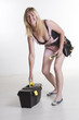 DIY attractive female worker with tools and toolbox