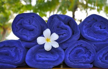 Frangipani flower between towels