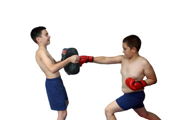Preschooler in red gloves trains punch the makiwara