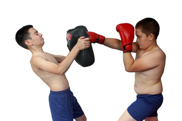 Young athlete learns to punch in the housing on the makiwara