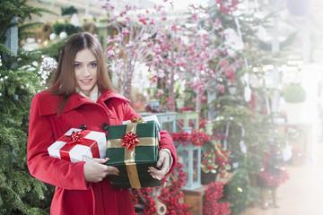Young woman buys christmas gifts