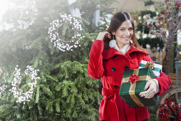 Young woman buys christmas gifts