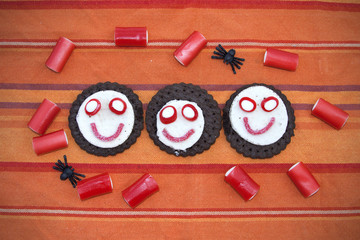 Smiling cookies with candies in Halloween festivities