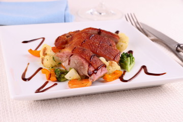 Roasted duck breast, vegetables, black sauce