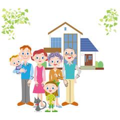 家の前に立つ仲良し家族